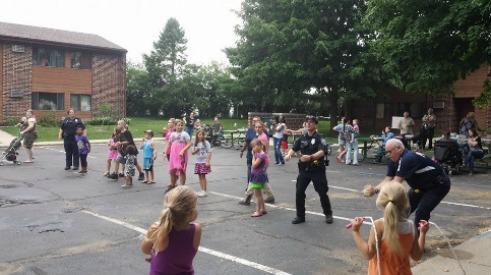 August 2014- Balloon Toss game with APD, Trooper Remley, and kids